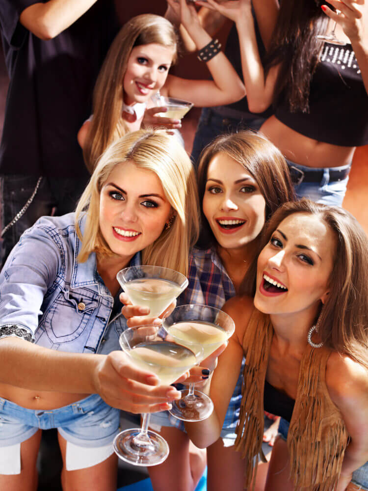 Sexy ladies drinking together at a Latin Party